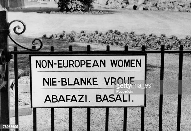 circa 1960's South Africa the country of Apartheid where black and whiteas the sign suggests go their different ways
