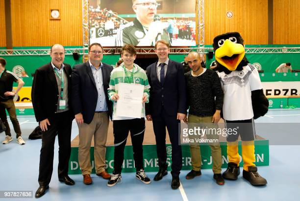 People pose as awards are handed out during the DFB Indoor Football ceremony on March 25 2018 in Gevelsberg Germany