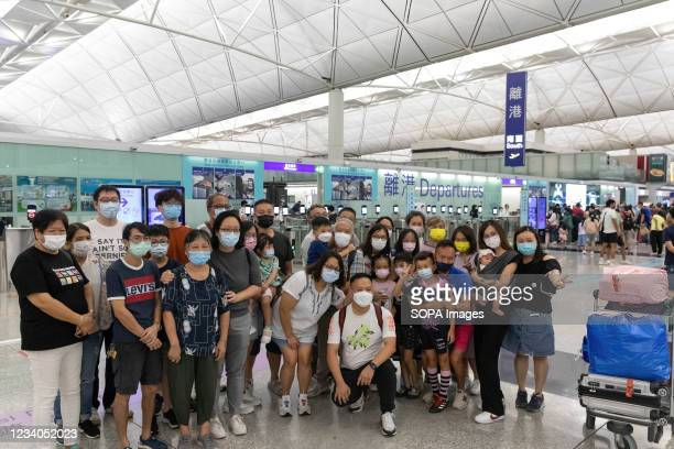 """People pose for a one last photo with their friends and families, at Hong Kong international airport a day before the deadline of """"Leave outside the..."""
