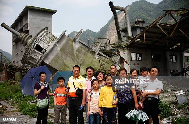 People pose for a photo at the ChuanXinDian Earthquake Ruin Park on May 3, 2009 in Shifang of Sichuan Province, China. Many commemoration activities...