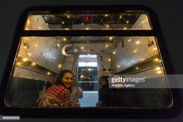 People pose for a photo in a compartment of the Eastern Express which travels from Ankara to Kars with lights ahead of departure in Ankara Turkey on...