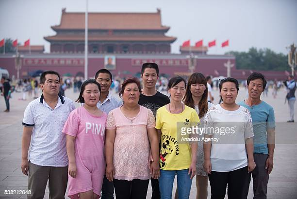 People pose for a photograph at the Tiananmen square - China's symbolic political heart - prior to the 27th anniversary of what some people refer to...