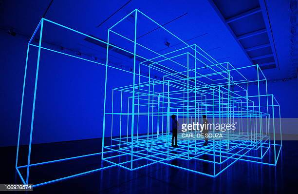 People pose for photographers in British artist Antony Gormley's new installation Breathing Room III during a photocall for his new exhibition 'Test...