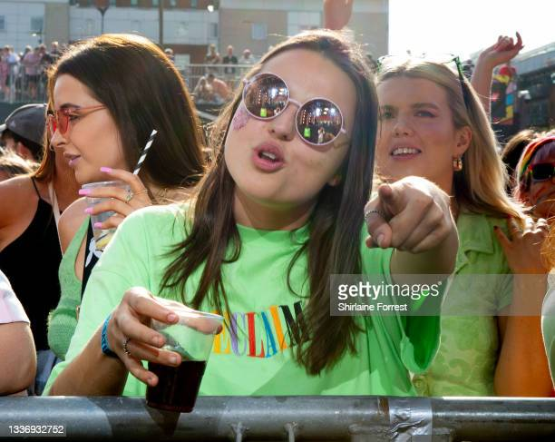 People pose for photos during Pride In Manchester 2021 on August 28, 2021 in Manchester, England.