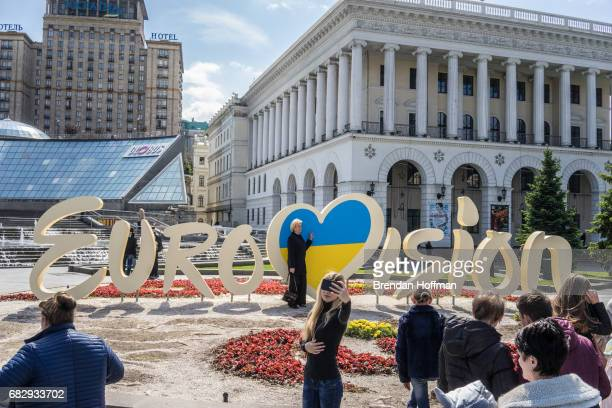 People pose for pictures in front of a Eurovision sign on Independence Square on May 11 2017 in Kiev Ukraine Ukraine is the 62nd host of the annual...