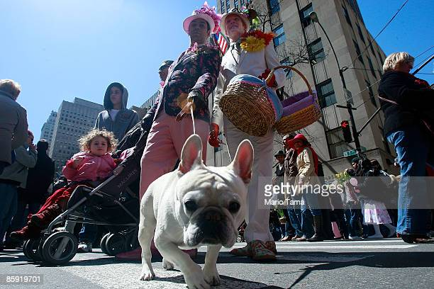 People pose in their holiday finery along Fifth Avenue during the annual Easter Parade April 12 2009 in New York City The parade is a New York...