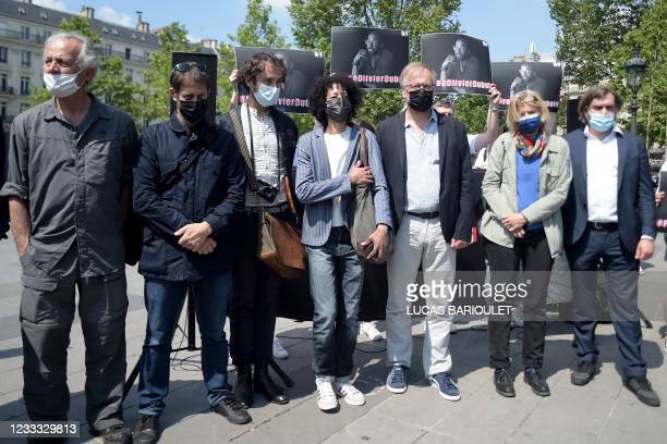 People pose on June 8, 2021 in Paris, during a gathering for French journalist Olivier Dubois, kidnapped in Northern Mali in April by a jihadist...