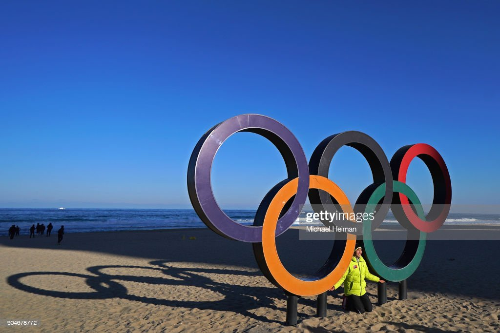 People pose on the Olympic Rings on Gyeongpo Beach in Gangneung ahead of the Pyeongchang 2018 Winter Olympics on January 12, 2018 in Pyeongchang-gun, South Korea.