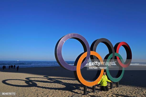 People pose on the Olympic Rings on Gyeongpo Beach in Gangneung ahead of the Pyeongchang 2018 Winter Olympics on January 12 2018 in Pyeongchanggun...