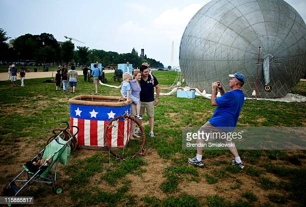 People pose with the basket of an American Civil Warera observation balloon during a demonstration on the National Mall June 11 2011 in Washington DC...