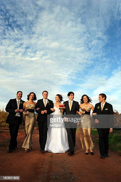 People posing for a photograph at a wedding