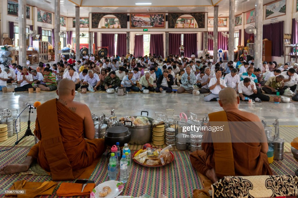 People pouring gruat nam holy water and monks for Boon Khao Jee at Wat Chan. : Stock Photo