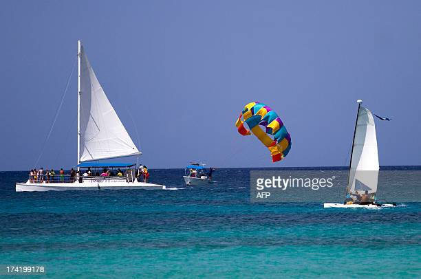 People practice aquatic sports at Dominicus beach in Bayahibe La Altagracia province Dominican Republic on July 21 2013 AFP PHOTO/Erika SANTELICES