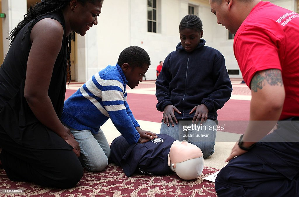 People practice CPR compressions on a mannequin at San Francisco City Hall on June 1, 2011 in San Francisco, California. The San Francisco Paramedic Association and the American Heart Association kicked off National CPR Week by offering free CPR training to the public.