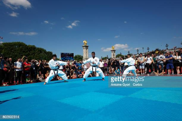 People practice judo on June 23 2017 in Paris during an event to promote the candidacy of the city of Paris for the Summer Olympics Games in 2024...