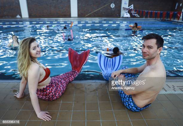 People practice swimming with mermaid tails at AquaMermaid swimming school a mermaid training school in Chicago United States on March 19 2017...
