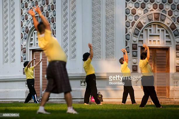 People practice tai chi at Lumphini Park in Bangkok Thailand on Sunday March 15 2015 Almost a third of Thailand's population will be over 60 by 2050...
