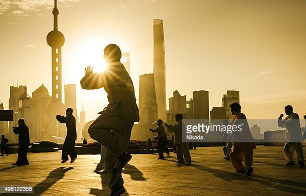 People practice tai chi in the Bund area, Shanghai