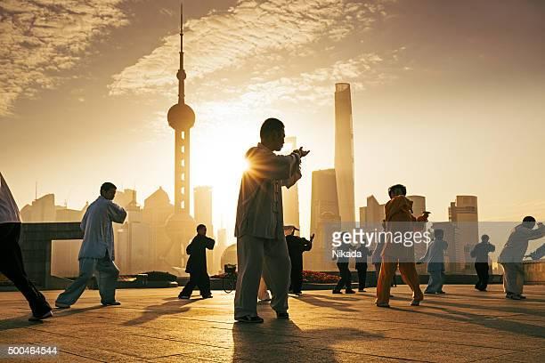 People practice tai chi in the Bund area, Shanghai