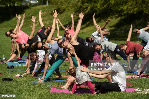 People practice yoga during activities marking Earth Day in Germia National Park near Pristina on April 22 2018 April 22 is observed as Earth Day...