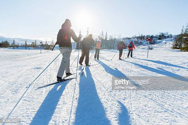 people practicing cross-country skiing - hill stock pictures, royalty-free photos & images