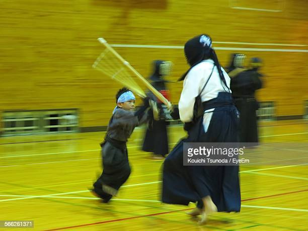 People Practicing Kendo In Court