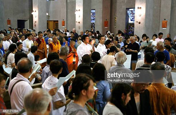 People pray a day before the 70th anniversary of the Hiroshima Atomic Bomb at Catholic Noboricho Church on August 5 2015 in Hiroshima Japan Japan is...