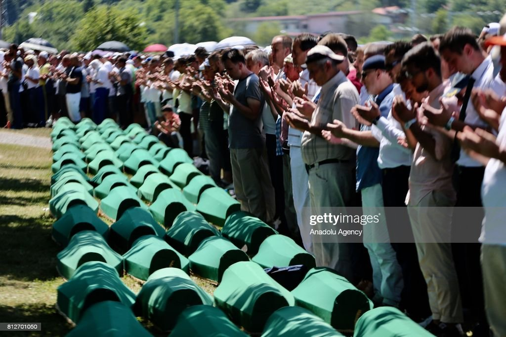 People pray after the funeral ceremony of newly identified 71 Srebrenica genocide victims, to mark the 22nd anniversary of the Srebrenica genocide, at Potocari Memorial Center in Potocari village of Srebrenica, Bosnia and Herzegovina on July 11, 2017. Serbian army led by Ratko Mladic carried out a genocide and killed more than 8 000 Bosnian in Srebrenica on 11th July 1995.