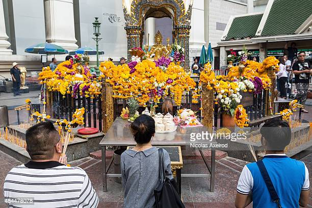 People pray and pay their respects at the Erawan Shrine on August 19, 2015 in Bangkok, Thailand. On Monday evening Bangkok was hit by what has been...
