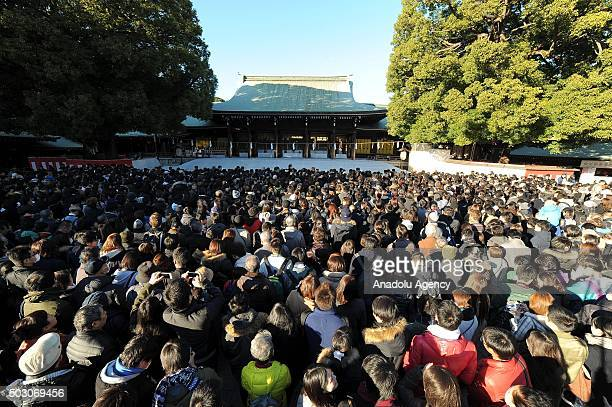 People pray and throw coins to offer prayers for the New Year at the Meiji Shrine in Tokyo Japan on January 1 2016 Japanese go to Shrine to ask for...