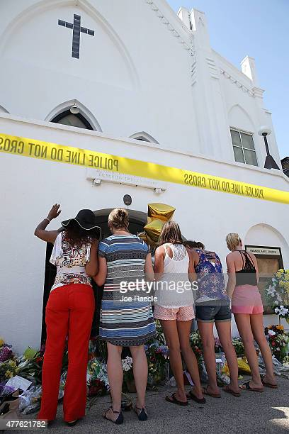 People pray as they pay their respects in front of Emanuel AME Church on June 18 2015 in Charleston South Carolina Nine people were killed on June 17...
