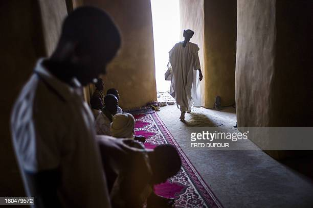 People pray at the Djingareyber mosque in Timbuktu on February 1 2013 The fabled desert city of Timbuktu an ancient centre of Islamic learning has...