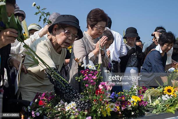People pray at the Hiroshima Peace Memorial after the 70th anniversary ceremony of the atomic bombing of Hiroshima at the Hiroshima Peace Memorial...