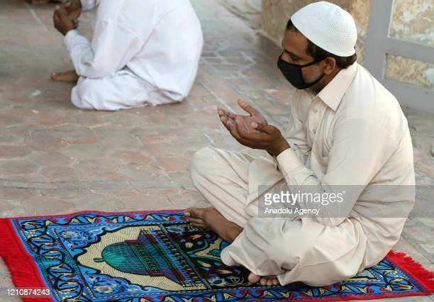 People pray at the Jamia Masjid during the Muslims weekly Friday prayers as the country observed April 24 Friday as Repentance and Blessings Day...