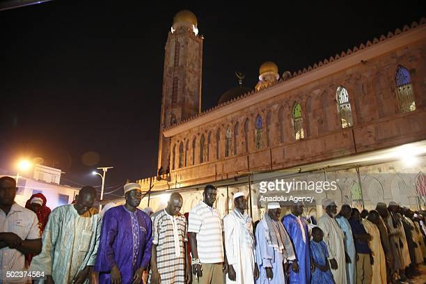 People pray at the Serigne Mbaye Sy Mosque for the Mawlid al Nabi ceremony marking the birth of the Prophet Muhammad organized by Senegalese Muslim...