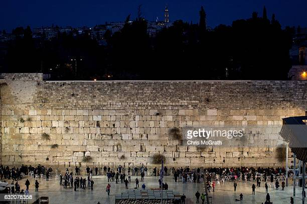 People pray at the Western Wall in the Old City on January 12 2017 in Jerusalem Israel 70 countries attended the recent Paris Peace Summit and called...