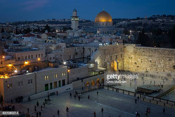 People pray at the Western Wall in the Old City on January 12, 2017 in Jerusalem, Israel. 70 countries attended the recent Paris Peace Summit and...