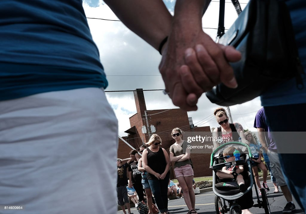 People pray before setting out on a march through the streets of Norwalk against the epidemic of heroin in their community on July 14, 2017 in Norwalk, Ohio. The day of action, called Hope Not Heroin, featured a march, speakers, and live bands. According to recent statistics, at least 4,149 Ohioans died from drug overdoses in 2016, a 36 percent leap from just the previous year and making Ohio the leader in the nationÕs overdose deaths.