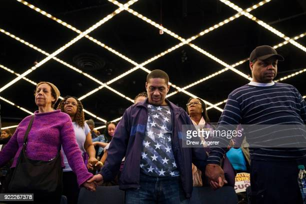 People pray before the start of a healthcare union rally at the Theater at Madison Square Garden February 21 2018 in New York City The rally was...