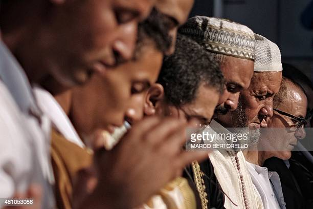 People pray during a celebration of Eid alFitr marking the end of the fasting month of Ramadan in Saluzzo near Turin on July 17 2015 Muslims around...