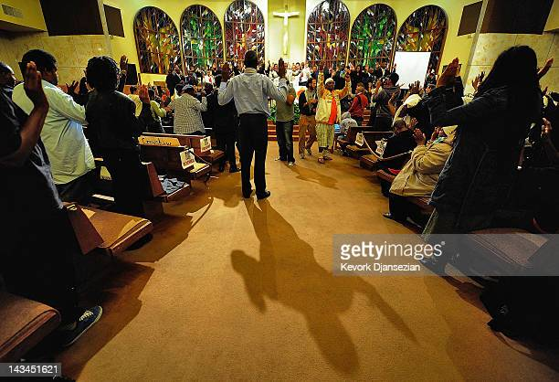 People pray during a rally at West Los Angeles Church in Christ to mark the two-month anniversary of Trayvon Martin's death on April 26, 2012 in Los...