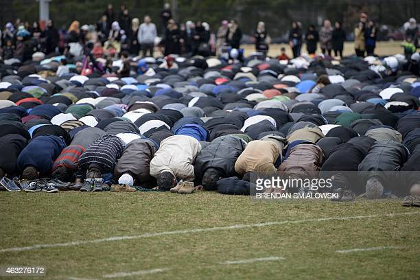 People pray during a service in a soccer field near the Islamic Association of Raleigh February 12 2015 in Raleigh North Carolina Community members...