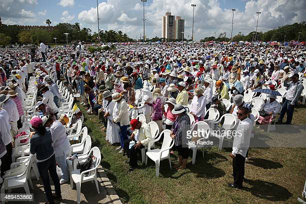 People pray during Mass in the Plaza de la Revolution held by Pope Francis on September 21 2015 in Holguin Cuba Pope Francis is spending his second...