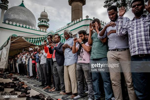 People pray during the burial ceremony of Abdalla Mohamed Dahir and Feisal Ahmed who were killed the previous day in an attack at the mosque in...