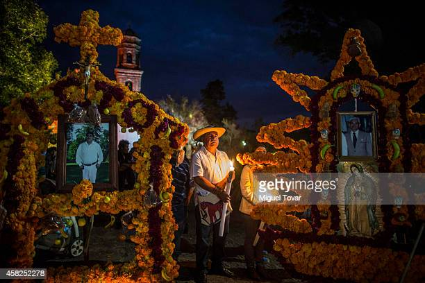People pray during the celebration of the Day of the Dead in which people remember those relatives and friends that have passed away on November 01...