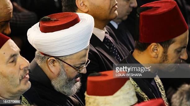 People pray during the funeral ceremony of Sunni Muslim cleric Mohamed Saeed alBouti who died in a suicide bomb attack on March 23 2013 at the...