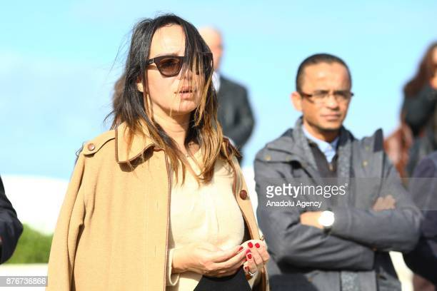 People pray during the funeral ceremony of Tunisian fashion designer Azzedine Alaia who died in aged 77 in Paris at the Sidi Bou Said Cemetery in...
