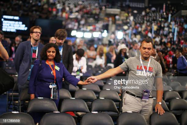 People pray during the invocation during day two of the Democratic National Convention at Time Warner Cable Arena on September 5 2012 in Charlotte...