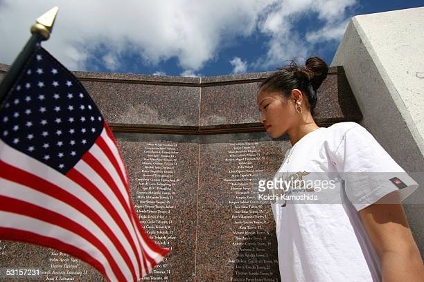 People pray during the Wreath Laying Ceremony at the American WWII Memorial on June 28, 2005 in Saipan, Northern Mariana Islands. Japan's Emperor...