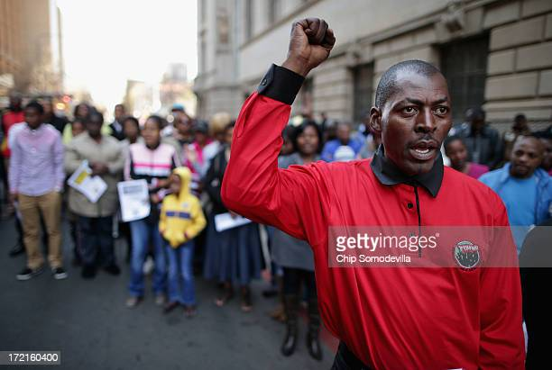 People pray for former South African President Nelson Mandela during a African National Congresssponsored prayer rally outside ANC headquarters July...